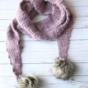 The Fuzzy Pom Scarf crochet pattern is made with Red Heart Hygge yarn.  This free crochet scarf pattern is easy enough for beginners, and makes a beautiful scarf that will keep you warm all winter long.  #crochetscarfpattern #redheartyarn #freecrochetpattern