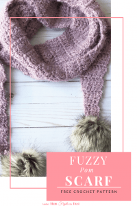 Fuzzy Pom Scarf Free crochet pattern.  This crochet scarf pattern is easy enough for beginners and works up quickly.  I used Red Heart Hygge yarn for a super soft, squishy scarf.  #freecrochetpattern #crochetscarfpattern